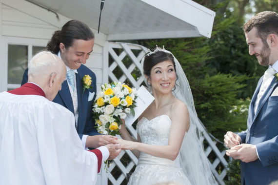 Japanese bride looks at the best man during the service