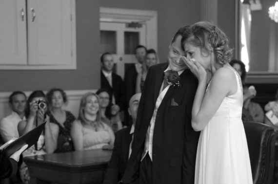 Emotional bride during the service