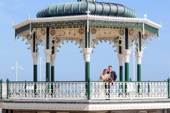 Bride and groom in Brighton's Band stand