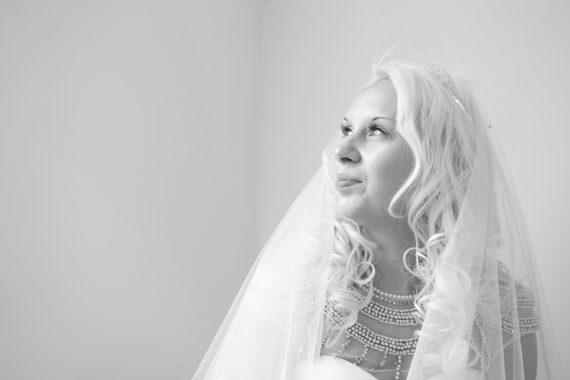 Bride looking towards window
