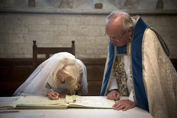 Bride signing the wedding certificate