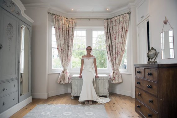 Bride in window after getting ready at home