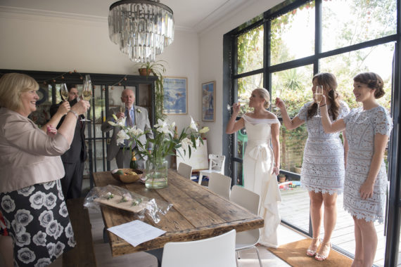 Family toasting with champagne at home
