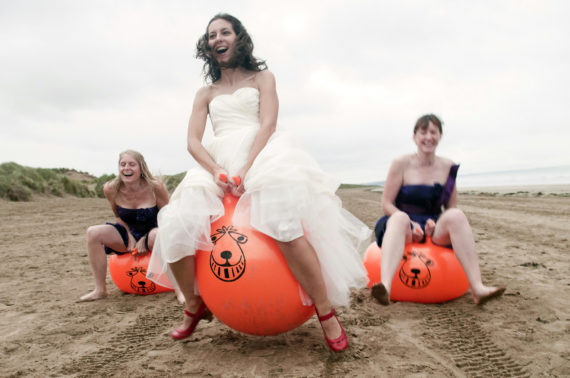 Bride races her friends on a space hopper