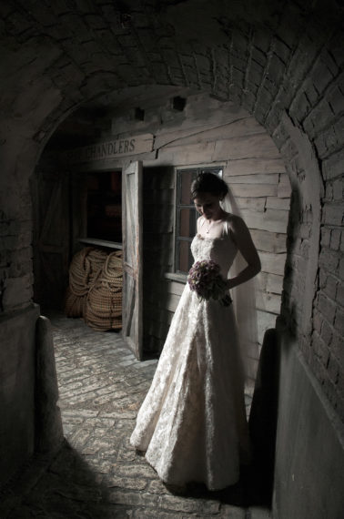 Bride in old fashioned alley way