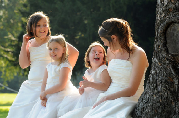 Bride sitting with her bridesmaids